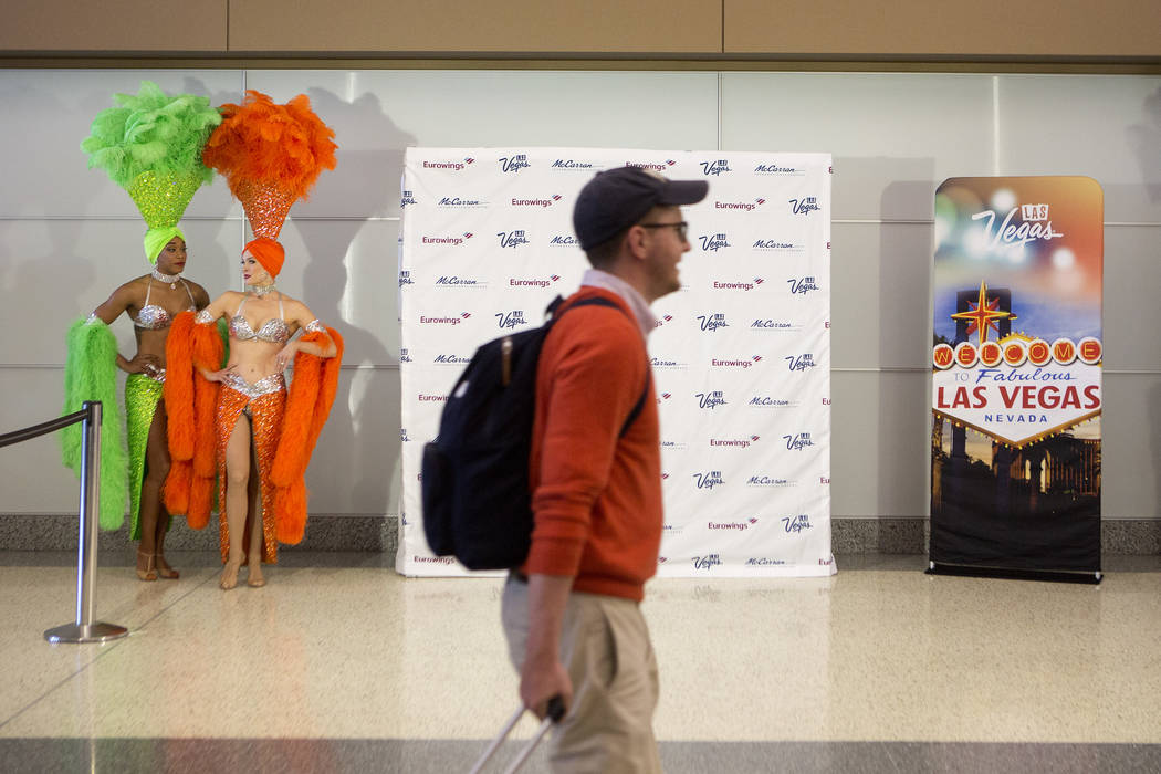 Passengers of the first Eurowings flight, that few direct from Cologne, Germany, are greeted by showgirls as they pass through McCarran International Airport on Friday, June 2, 2017 in Las Vegas.  ...