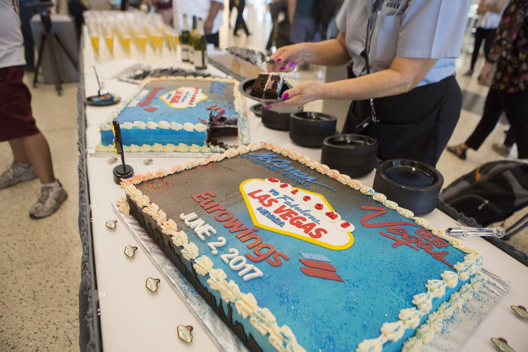 Cake is cut in celebration of the first Eurowings flight that few direct from Cologne, Germany at McCarran International Airport on Friday, June 2, 2017 in Las Vegas. Bridget Bennett Las Vegas Rev ...
