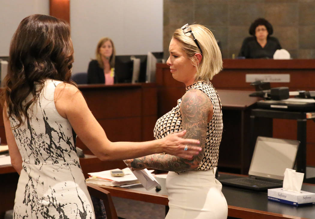 Christine Mackinday, right, ex-girlfriend of Jonathan Koppenhaver, aka War Machine, comforted by prosecutor Jacqueline Bluth after delivering her victim-impact statement at the Regional Justice Ce ...