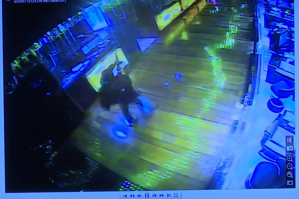 This image taken from TV of CCTV video shows a gunman firing a weapon into the air inside a casino in the Resorts World Manila complex before starting fires and firing on security forces Friday Ju ...