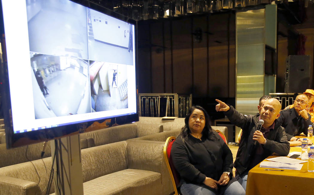 Armeen Gomez, second from left, chief security officer of Resort World Manila, points to the cctv footage where private guards engaged the gunman in a firefight as they play a video of the gunman  ...
