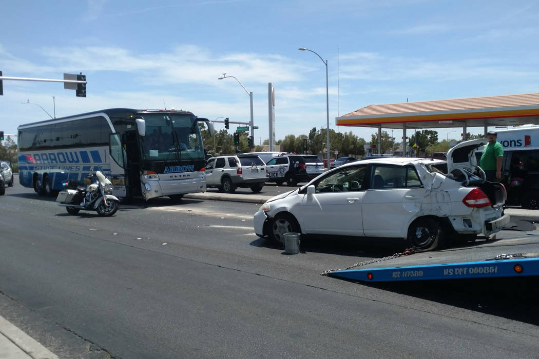 A sedan involved in a six-vehicle crash is flipped back over following a collision with a tour bus. Max Michor Las Vegas Review-Journal