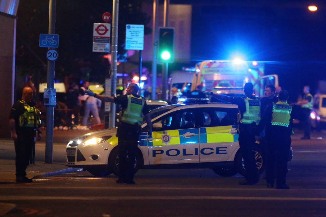 Police attend to an incident near London Bridge in London, Britain, June 3, 2017. REUTERS/Neil Hall