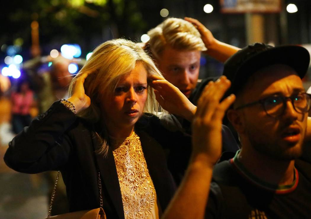 People leave the area with their hands up after an incident near London Bridge in London, Britain June 4, 2017. REUTERS/Neil Hall