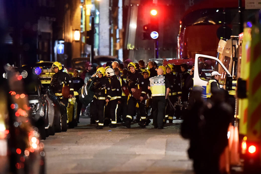 Emergency services attend to an incident near London Bridge in London, Britain, June 4, 2017. REUTERS/Hannah McKay