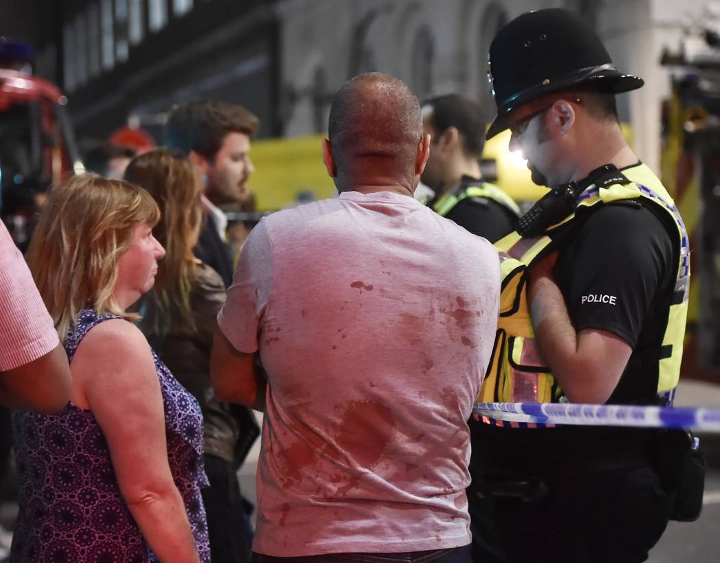 People speak with police officers after an incident near London Bridge in London, Britain June 4, 2017. REUTERS/Hannah Mckay