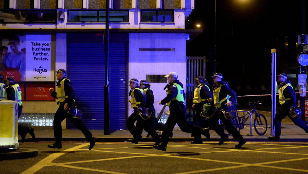 Police attend to an incident on London Bridge in London, Britain, June 3, 2017. Reuters / Hannah McKay     TPX IMAGES OF THE DAY