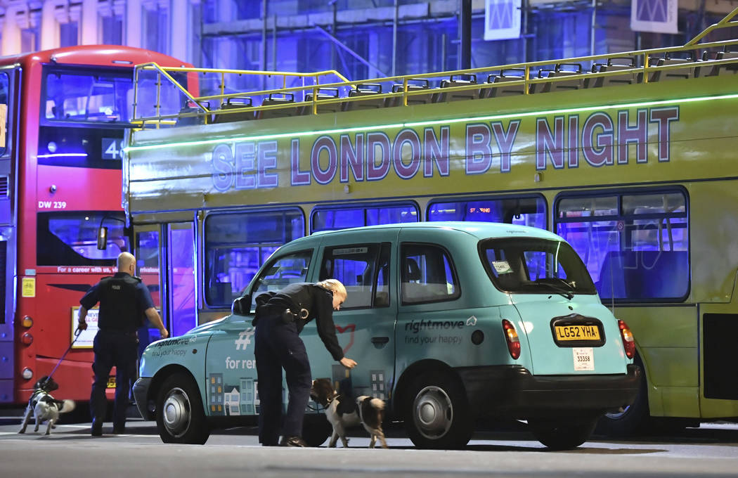"""Police sniffer dogs on London Bridge after an incident in central London, Saturday, June 3, 2017.  British police said they were dealing with """"incidents"""" on London Bridge and nea ..."""