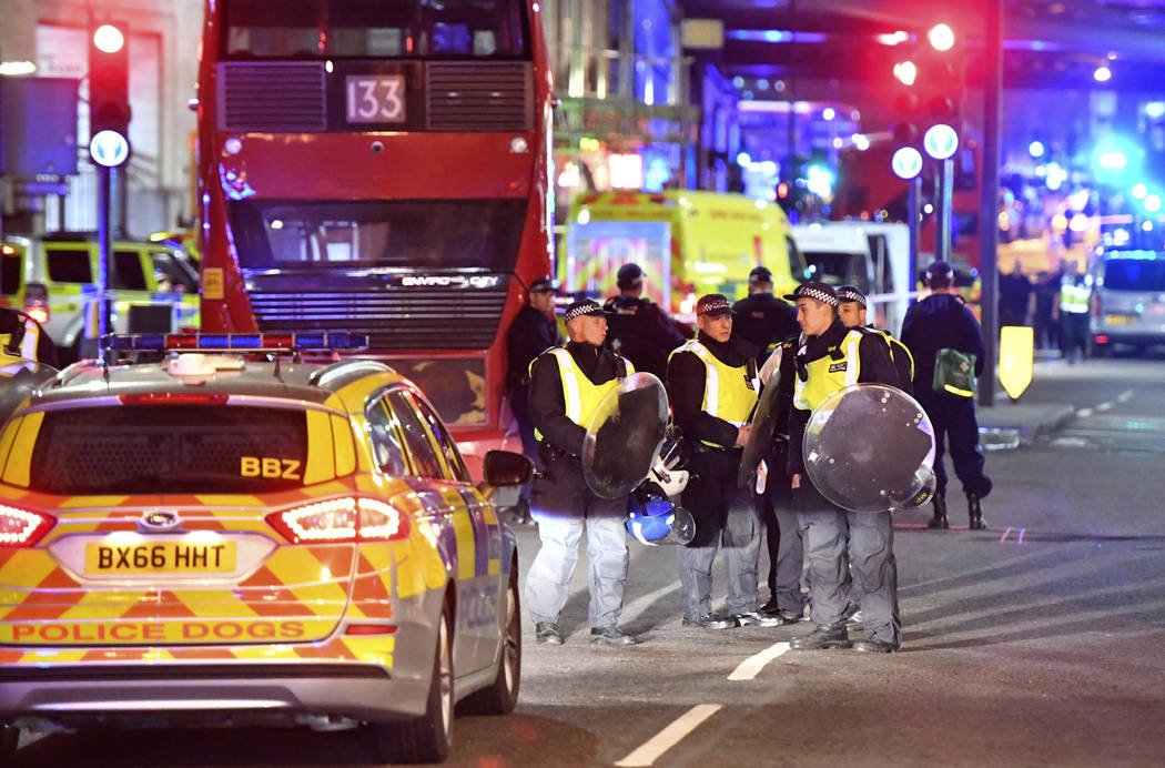 """Police officers with riot shields on Borough High Street after an incident in central London, Saturday, June 3, 2017.  British police said they were dealing with """"incidents"""" on L ..."""