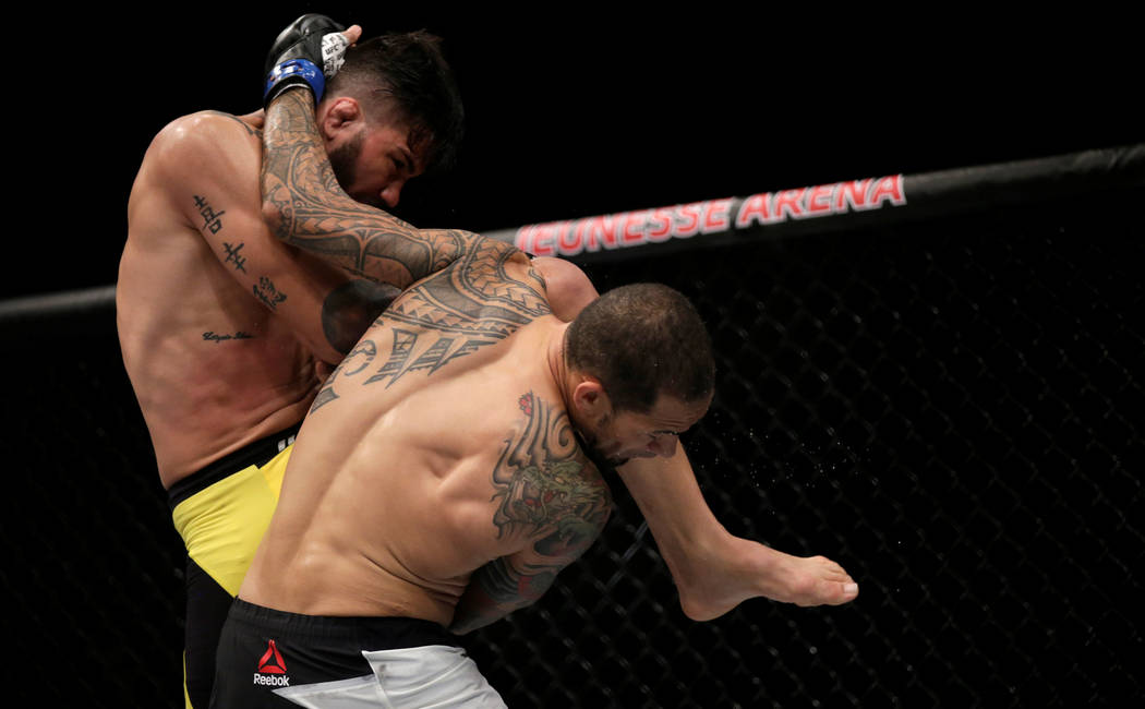 REFILE - CORRECTING TYPO IN MARTIAL MMA - Mixed Martial Arts -  UFC 212 - Jeunesse Arena, Rio de Janeiro, Brazil - 3/6/17 - Erick Silva (L) of Brazil and Yancy Medeiros of US in action. REUTERS/Ri ...