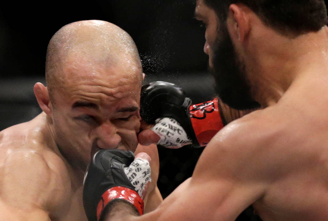 REFILE - CORRECTING TYPO IN MARTIAL MMA - Mixed Martial Arts -  UFC 212 - Jeunesse Arena, Rio de Janeiro, Brazil - 3/6/17 - Raphael Assuncao (R) of Brazil and Marlon Moraes of Brazil in action. RE ...