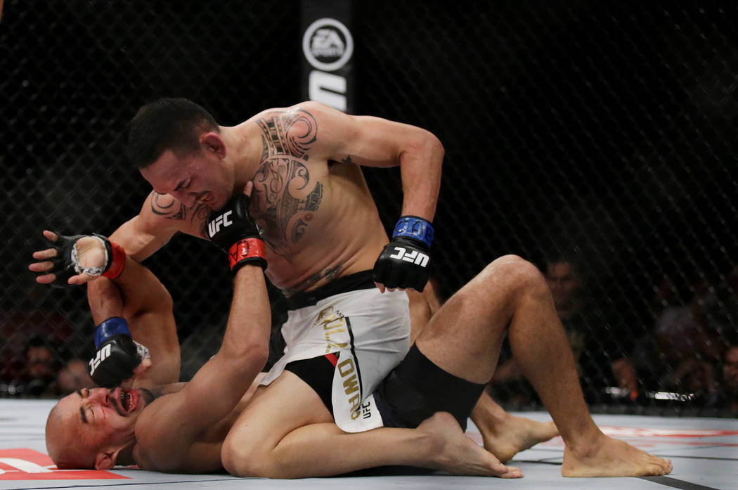MMA - Mixed Martial Arts -  UFC 212 - Jeunesse Arena, Rio de Janeiro, Brazil - 3/6/17 - Jose Aldo (Bottom) of Brazil and Max Holloway of US in action. REUTERS/Ricardo Moraes