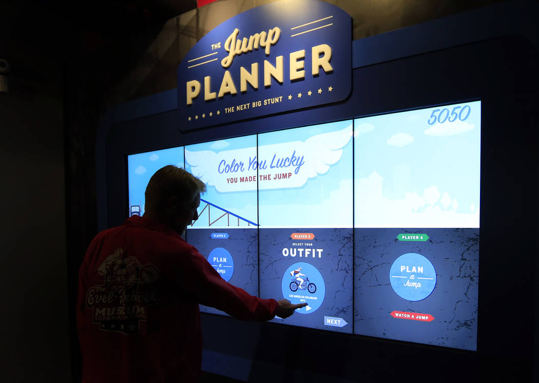 A member of the museum staff demonstrates the Jump Planner at the Evel Knievel Museum in Topeka, Kan., Friday, June 2, 2017. (AP Photo/Orlin Wagner)