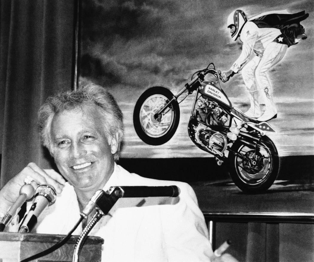 Stuntman Evel Knievel, who gave up trying to jump over buses and canyons on a motorcycle after a serious accident in 1979, speaks during a news conference in Los Angeles in 1986. (AP Photo/Mark Te ...