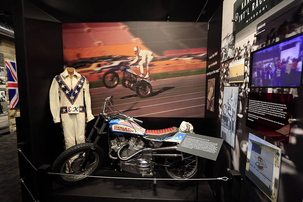 The cycle and leathers used by Evel Knievel at his Kansas City International Speedway jump are on display at the Evel Knievel Museum in Topeka, Kan., Friday, June 2, 2017.  (AP Photo/Orlin Wagner)