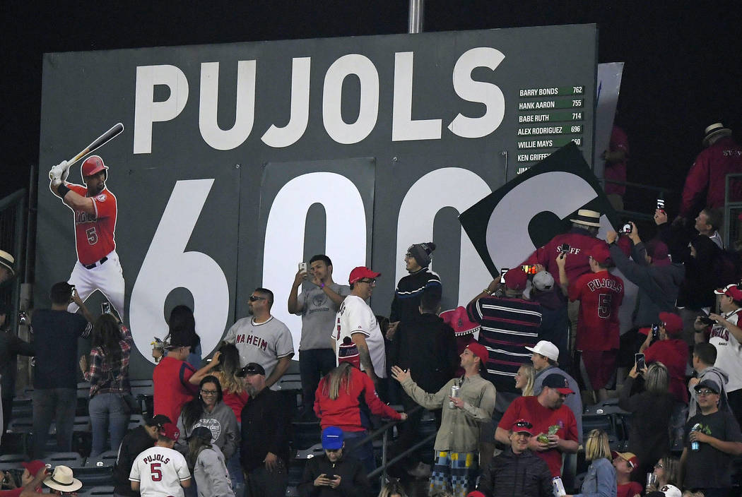 "A sign in center field for Los Angeles Angels' Albert Pujols is changed to ""600"" after Pujols hit a grand slam, his 600th homer, during the fourth inning of a baseball game against the Minnesota T ..."
