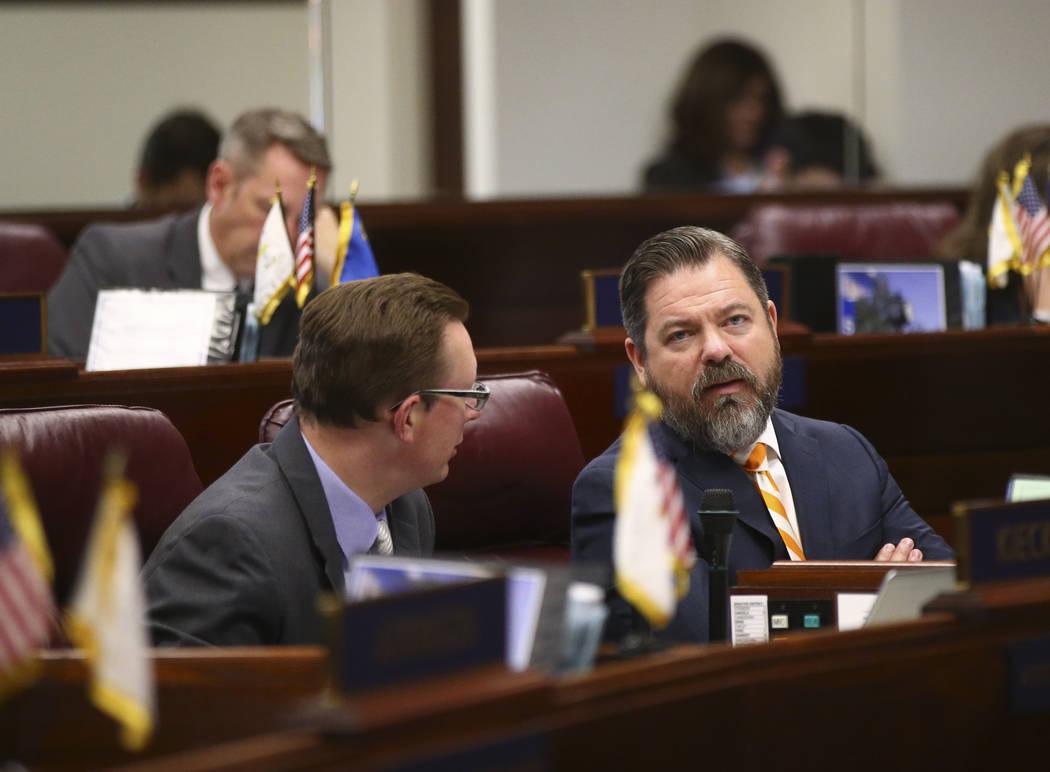 Sen. Ben Kieckhefer, R-Reno, left, talks with Senate Minority Leader Michael Roberson, R-Henderson, during the second to last day of the Nevada Legislature at the Legislative Building in Carson Ci ...