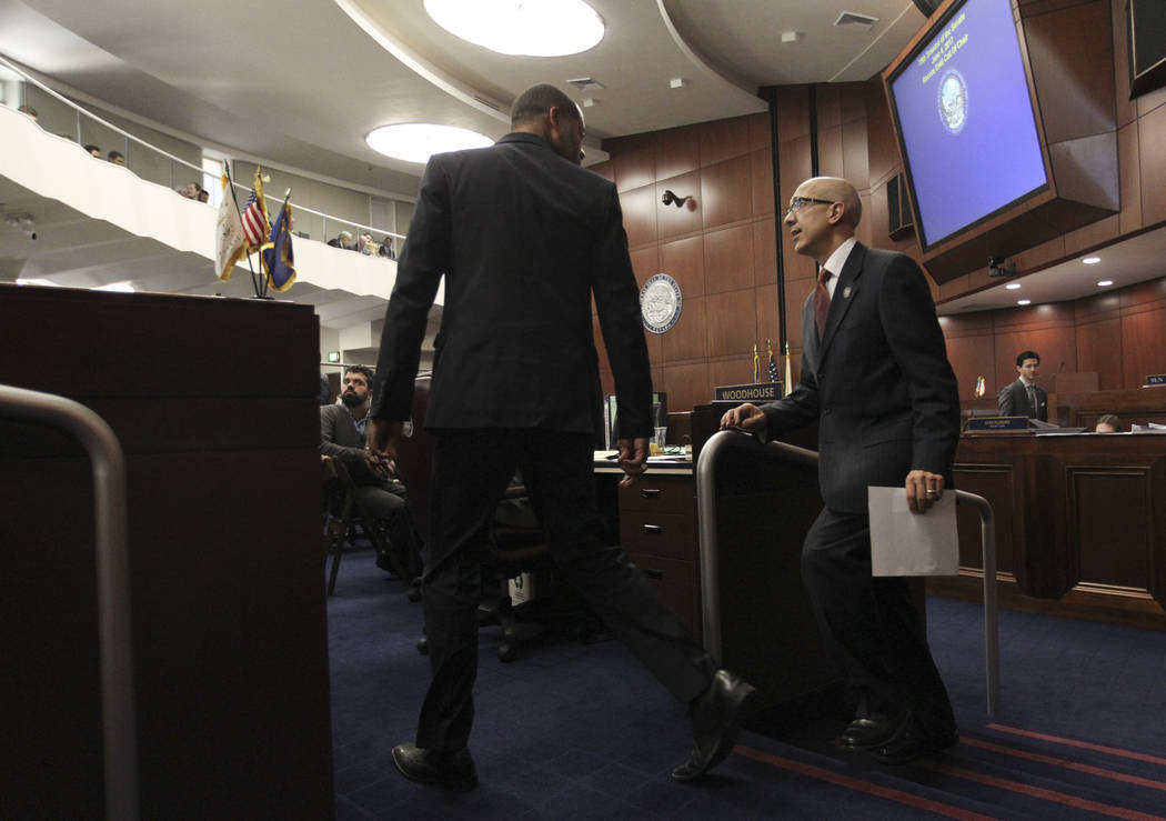 Senate Majority Leader Aaron Ford, D-Las Vegas, left, talks with Sen. Mo Denis, D-Las Vegas, during the second to last day of the Nevada Legislature at the Legislative Building in Carson City on S ...