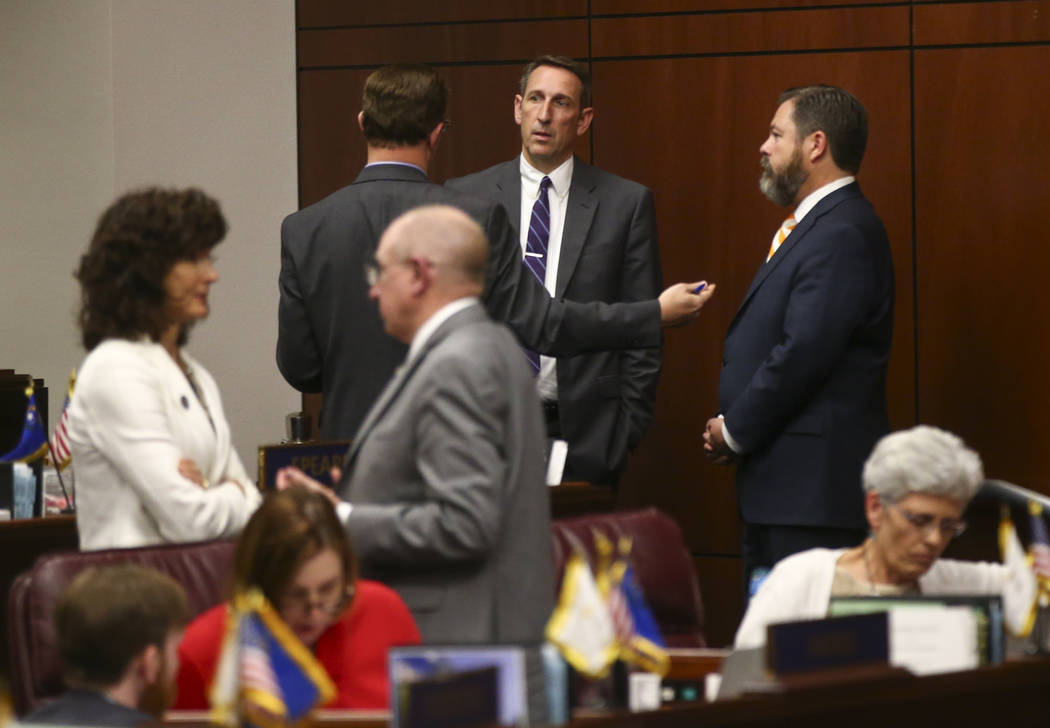 Sen. Scott Hammond, R-Las Vegas, fourth from left, talks with Sen. Ben Kieckhefer, R-Reno, as Senate Minority Leader Michael Roberson, R-Henderson, right, looks on during the second to last day of ...