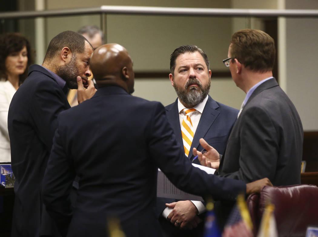 Senate Majority Leader Aaron Ford, D-Las Vegas, from left, Sen. Kelvin Atkinson, D-North Las Vegas, Senate Minority Leader Michael Roberson, R-Henderson, and Sen. Ben Kieckhefer, R-Reno, before vo ...