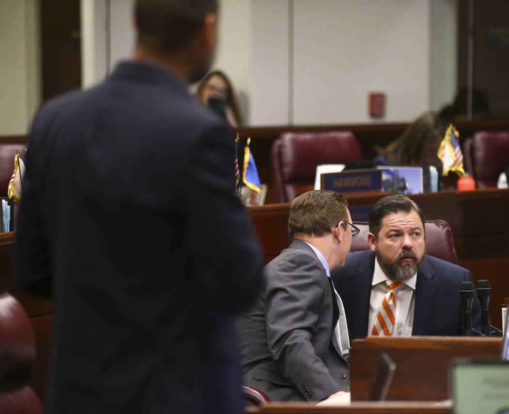 Sen. Ben Kieckhefer, R-Reno, left, talks with Senate Minority Leader Michael Roberson, R-Henderson, during the second to last day of the Nevada Legislative session at the Legislative Building in C ...