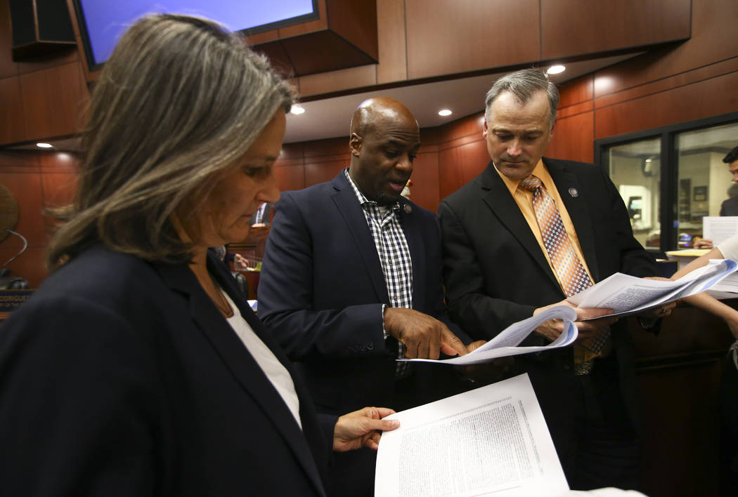 Sen. Julia Ratti, D-Sparks, from left, Sen. Kelvin Atkinson, D-North Las Vegas, and Sen. James Settelmeyer, R-Minden, before voting on Senate Bill 555 during the second to last day of the Nevada L ...