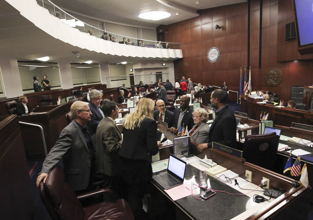 Senators confer during the second to last day of the Nevada Legislature at the Legislative Building in Carson City on Sunday, June 4, 2017. Chase Stevens Las Vegas Review-Journal @csstevensphoto