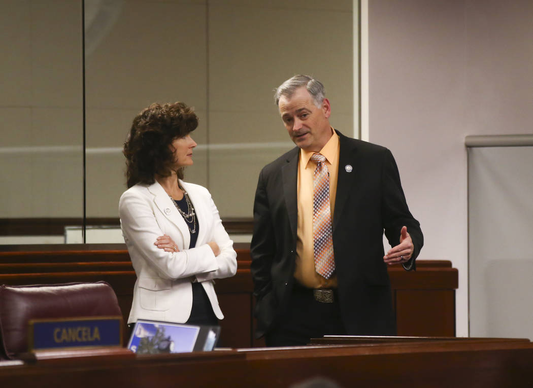 Sen. Heidi Gansert, R-Reno, left, talks with Sen. James Settelmeyer, R-Minden, during the second to last day of the Nevada Legislature at the Legislative Building in Carson City on Sunday, June 4, ...