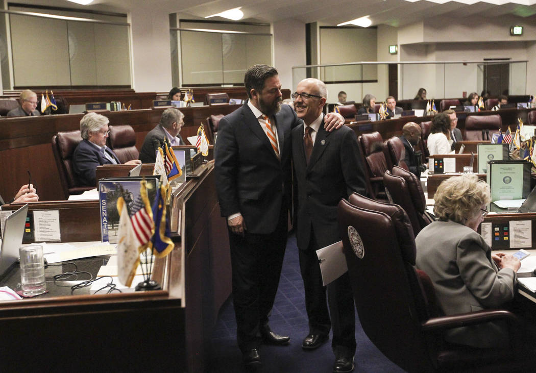 Senate Minority Leader Michael Roberson, R-Henderson, left, and Sen. Mo Denis, D-Las Vegas, during the second to last day of the Nevada Legislature at the Legislative Building in Carson City on Su ...