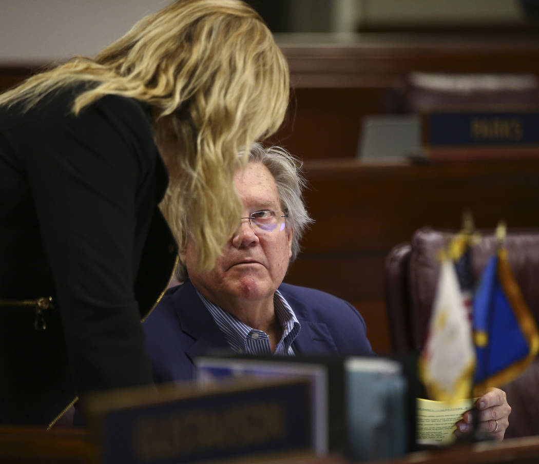 Sen. Patricia Farley, I-Las Vegas, left, talks with Sen. Tick Segerblom, D-Las Vegas, during the second to last day of the Nevada Legislature at the Legislative Building in Carson City on Sunday,  ...