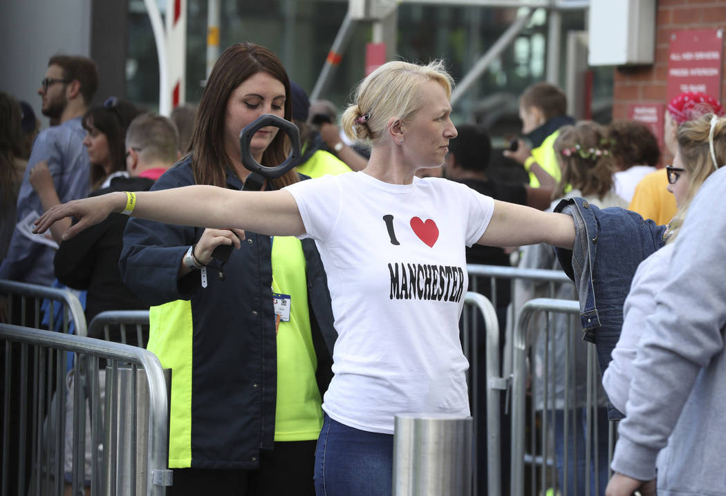 Security staff check people arriving for the One Love Manchester benefit concert Sunday June 4, 2017, for the victims of last month's Manchester Arena terror attack at the Emirates Old Trafford, M ...