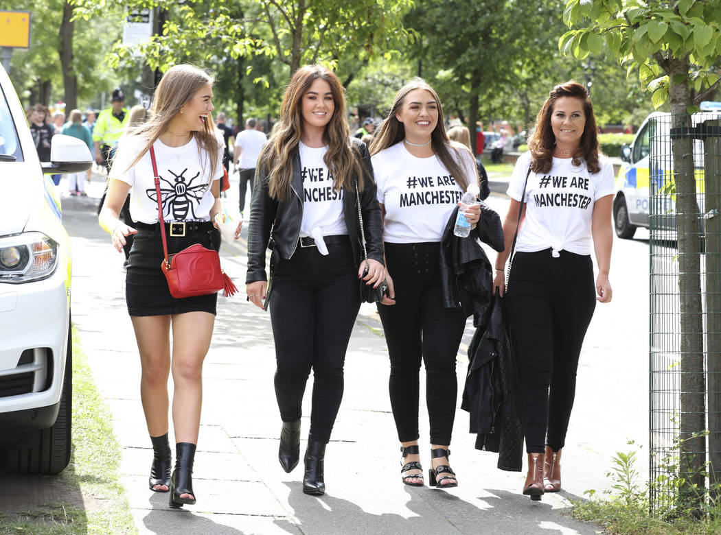 Crowds arrive to attend the One Love Manchester benefit concert Sunday June 4, 2017, for the victims of last month's Manchester Arena terror attack at the Emirates Old Trafford, Manchester, Englan ...