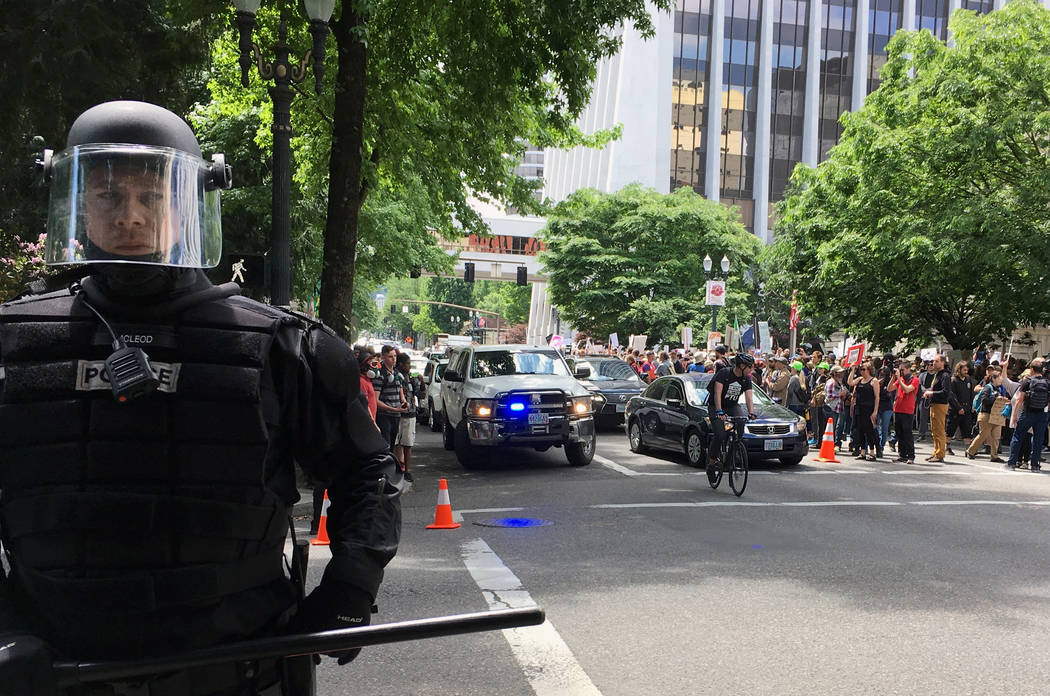 Thousands of protesters gather in Portland, Ore., Sunday, June 4, 2017, for competing rallies following last month's fatal stabbing of two men on a light-rail train by a man police say was shout ...