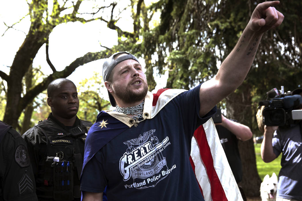 FILE - In this April 29, 2017, file photo provided by John Rudoff, Jeremy Joseph Christian, right, talks during a Patriot Prayer organized by a pro-Trump group in Portland, Ore. Christian, the man ...