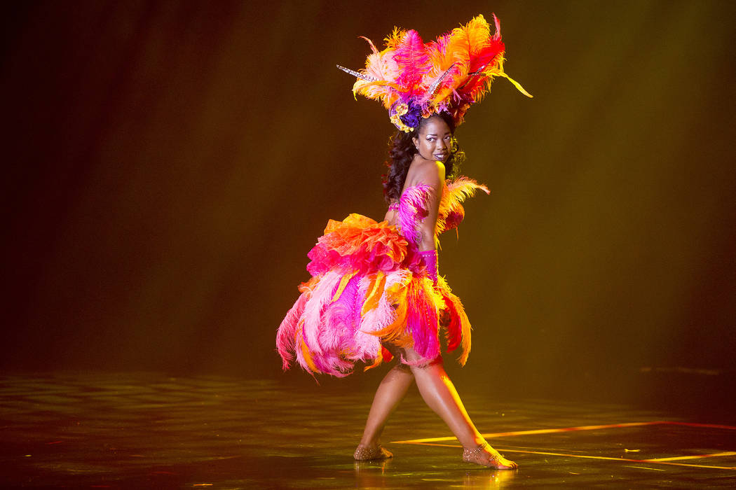 """Jessabelle Thunder from Los Angeles begins her performance during the """"Tournament of Tease"""" in part of the Burlesque Hall of Fame Weekender at the Orleans Showroom in Orleans hotel-casino on Satur ..."""