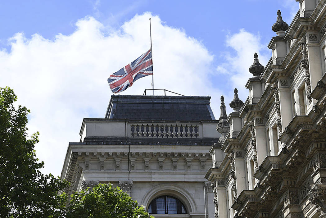 The Union flag flies at half mast in Whitehall, central London, Sunday June 4, 2017, after Saturday night's terrorist incident on London Bridge and at Borough Market. (Stefan Rousseau/PA via AP)