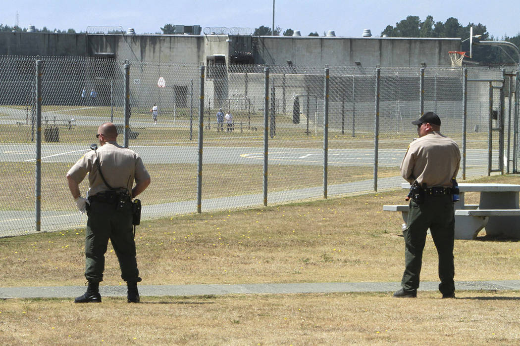 Correctional officers keep watch on inmates on the recreation yard at Pelican Bay State Prison near Crescent City, Calif., in 2011.  (AP Photo/Rich Pedroncelli, File)