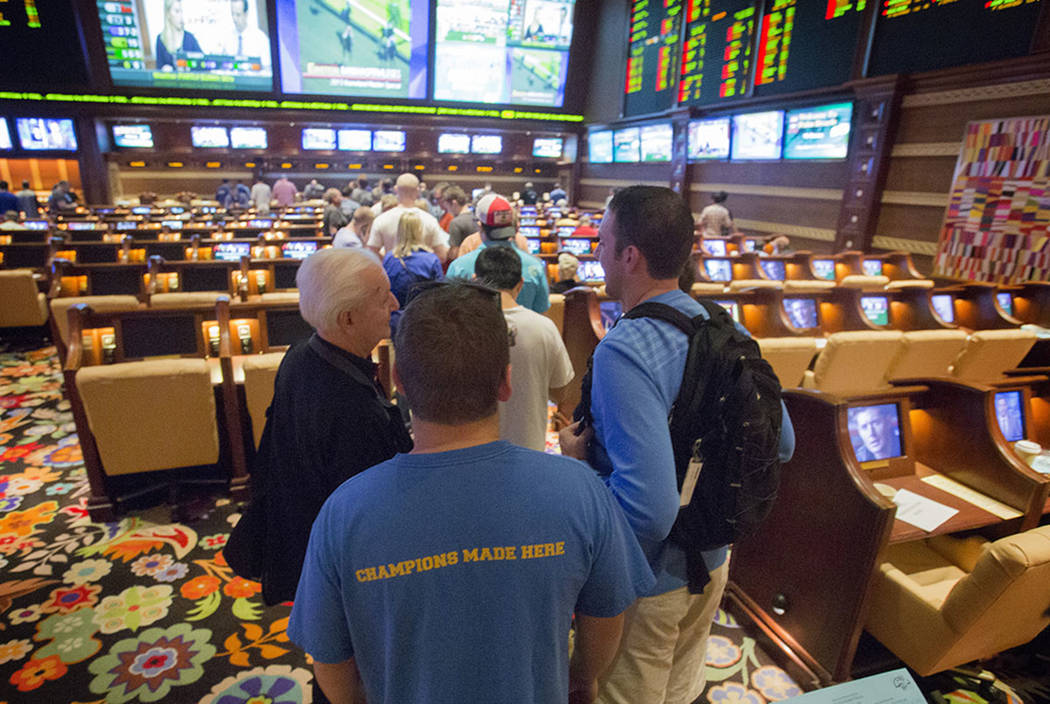 Bettors stand in line at Wynn Race and Sports Book during NCAA Men's basketball tournament  on Friday, March 21, 2014. (Las Vegas Review-Journal)