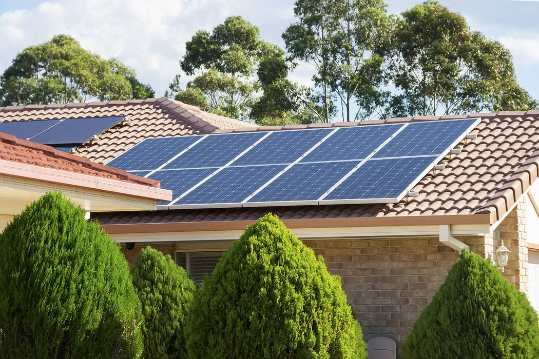 Photovoltaic panels like the ones on this homeճ rooftop generate electric power by using solar cells to convert energy from the sun. THINKSTOCK photo