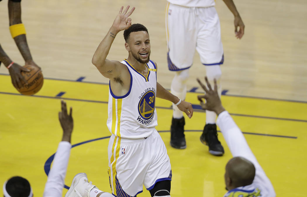 Golden State Warriors guard Stephen Curry (30) gestures after scoring against the Cleveland Cavaliers during the first half of Game 2 of basketball's NBA Finals in Oakland, Calif., Sunday, June 4, ...
