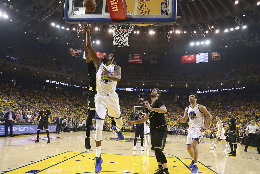 Golden State Warriors forward Kevin Durant shoots against the Cleveland Cavaliers during the first half of Game 2 of basketball's NBA Finals in Oakland, Calif., Sunday, June 4, 2017. (Ezra Shaw/Po ...