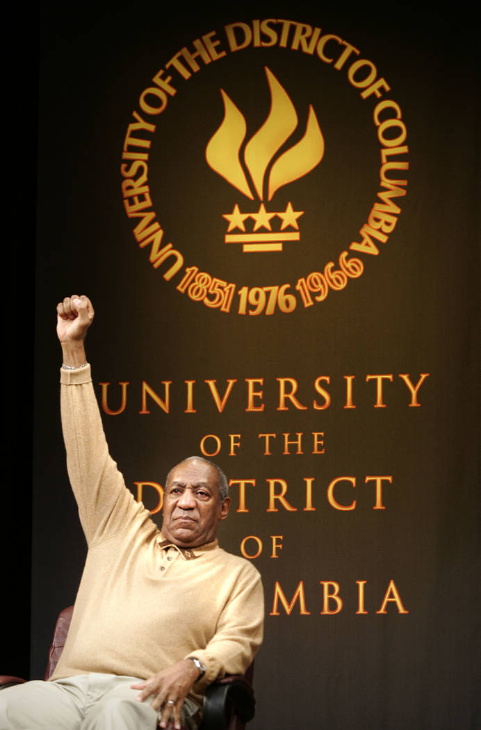 FILE - In this Tuesday, May 16, 2006 file photo, entertainer Bill Cosby raises his arm to the audience on the campus of University of the District of Columbia in Washington. The panel discussion o ...