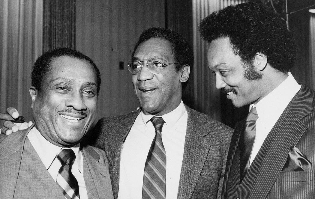 FILE - In this April 1, 1982 file photo, John H. Johnson, publisher of Jet and Ebony magazines, left, and actor Bill Cosby, center, join the Rev. Jesse Jackson at a benefit reception for Operation ...