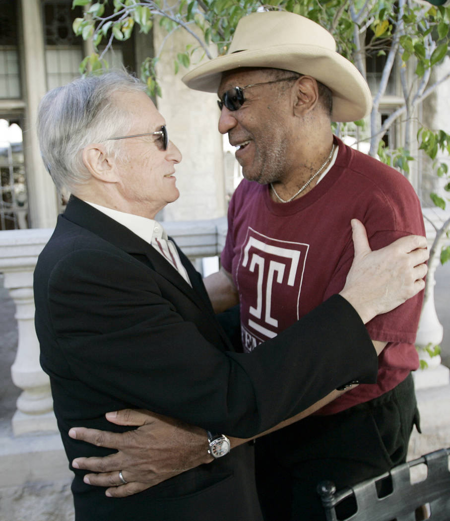 FILE - In this Wednesday, Feb. 27, 2008 file photo, Bill Cosby, host of the Playboy Jazz Festival, right, and Playboy impresario Hugh Hefner greet each other at a party to announce the lineup of t ...