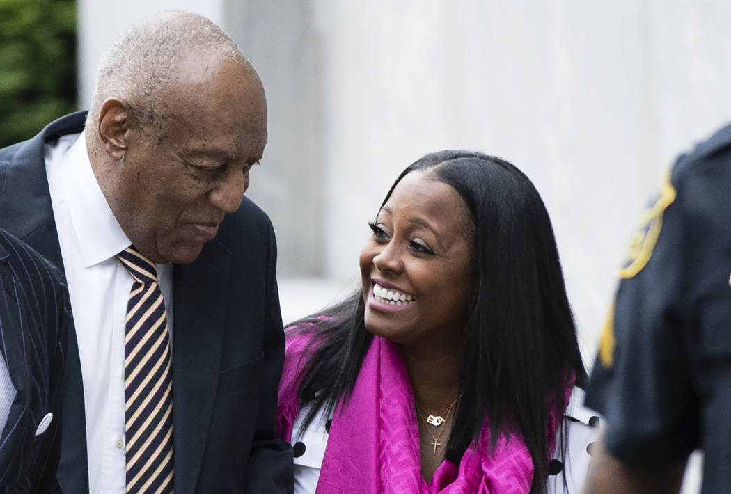 ADDS NAME - Bill Cosby arrives for his sexual assault trial with Keshia Knight Pulliam, right, at the Montgomery County Courthouse in Norristown, Pa., Monday, June 5, 2017. (AP Photo/Matt Rourke)