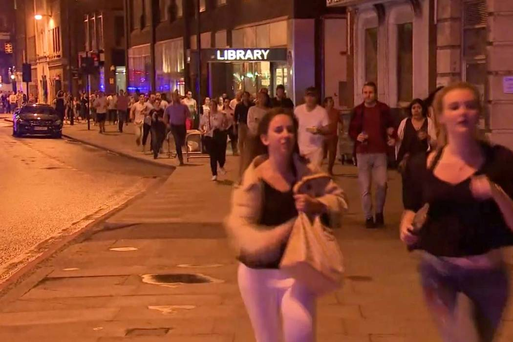 In this Saturday, June 3, 2017, image made from a video, people run from the scene an attack in London. Chaos broke out for several minutes during Saturday night's attack in the heart of the city, ...