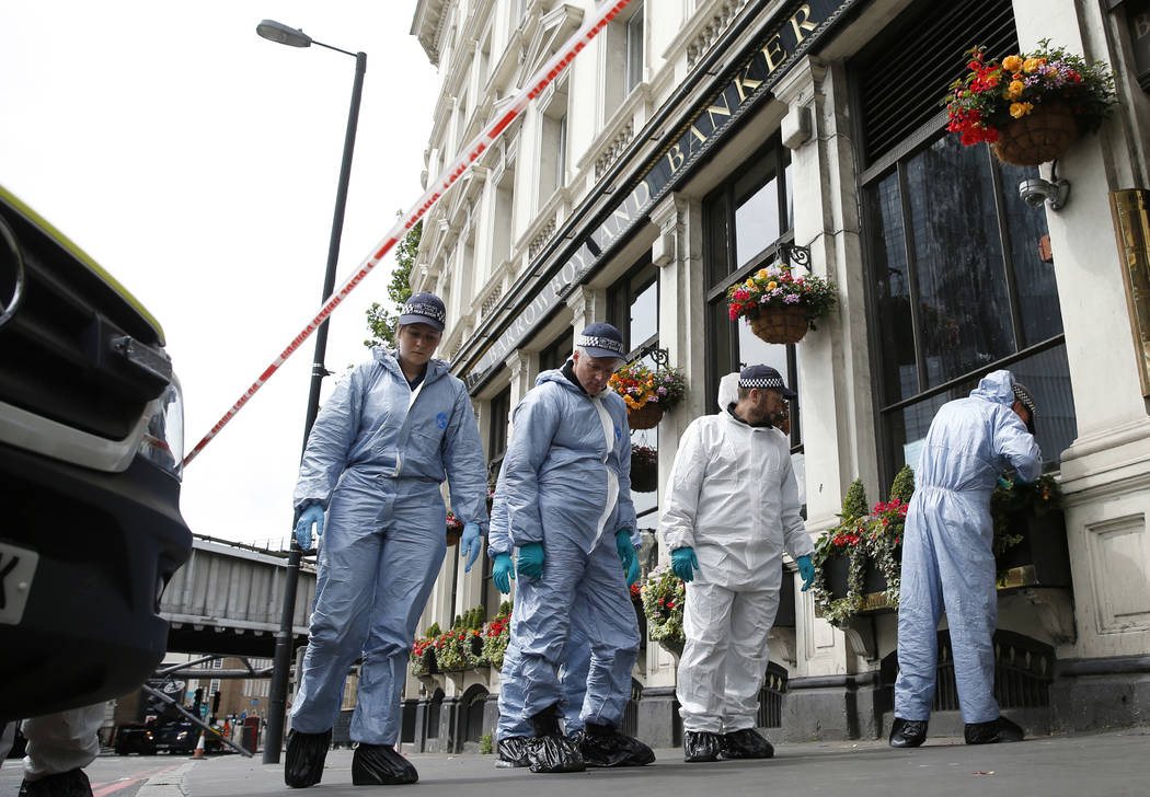 Forensic police investigate around the Borough Market and London Bridge area of London, Monday, June 5, 2017. Police arrested several people and are widening their investigation after a series of  ...