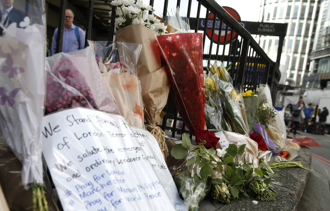 Floral tributes line the pavement outside Monument underground station in the London Bridge area of London, Monday, June 5, 2017. (Alastair Grant/AP)