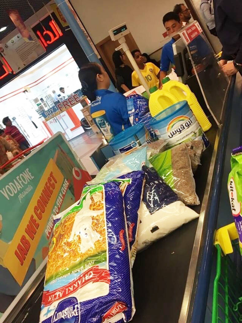People are seen buying essential food staples at a supermarket in Doha, Qatar, Monday, June 5, 2017. Four Arab nations have cut diplomatic ties to Qatar, further deepening a rift between Gulf Arab ...