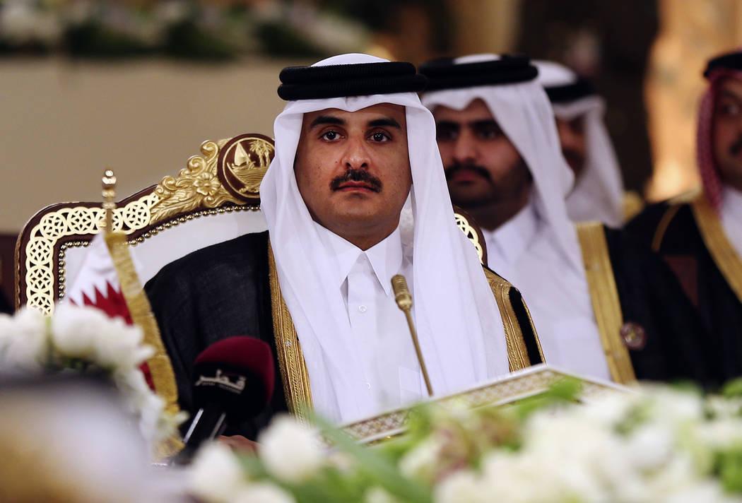 Qatar's Emir Sheikh Tamim bin Hamad Al-Thani attends a Gulf Cooperation Council summit in Doha, Qatar, on Tuesday, Dec. 9, 2014. Bahrain says it is cutting diplomatic ties to Qatar amid a deepenin ...